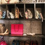 adorable branded and stylish handbag storage design with leopard pattern in the backsplash with pink bag stylish shoes and wooden rack