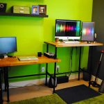 adorable greeen room design with double sitting and standing desk design with wooden countertop and metal black legs with green rug
