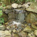 Adorable Simple Nice Classic Water Feature For Home With Rock Wall Concept And Clear Water Fall In The Forest Or Gargen