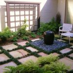 adorable small backyard landscape design with plotted patio design with shrub and potted plants and black ceramic with fountain and pebble and white chairs