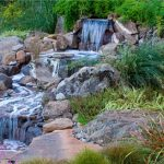 Amazing Fresh Green Natural Water Feature For Home With Green Plant Concept And Big Rocks Design Like River Water Course Very Adorable