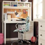 amazing white storage design in student desk with blue polka dot patterned swivel chair upon dark flooring idea beneath storage with pink dust bin