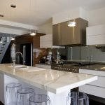 Antique Kitchen Design With White Cabinet And White Acrylic Backsplash With Wooden Cupboard And White Kitchen Island And Round Acrylic Chairs