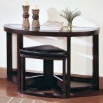arched black wooden extra long console design with corner leather bench design beneath with artistic ornaments upon brown laminated flooring idea