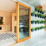 arrangements of wall mount pots for fresh and green plants as the part of go green home program a  large sliding glass door with wood frame in most energy efficience home