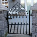 artistic and beautiful wrought iron gate in black paint color