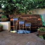 attractive-adorable-nice-cool-classic-water-feature-for-home-with-wooden-wall-concept-with-three-water-fall-design-with-small-pool-drop-and-nice-flower-decoration