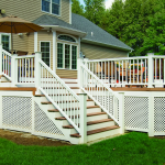 Awesom White Porch Idea Of Big House With White Fencing Design With Lattice Porch Skirting With Staircase With Grassy Meadow