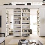 awesome room separators ikea in modern style with bookshelves and wooden table plus comfy white chair and brown sofa plus standing lamp