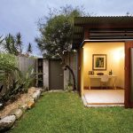 Backyard Sheds Turned Into Homes For Adorable Home Office With Desk And Chair Plus Green Garden And Wooden Fence