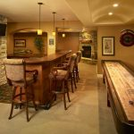 basement bar idea with semi classic barstools billiard table yard curved bar table three pendant lamps wall mount flat TV screen