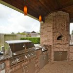 bbq gas hibachi grill for home in outdoor kitchen with brick wall cabinets