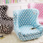beautiful and adorable comfy bedroom chairs in blue pink anc black with small polkadot pattern and electricity plug upon furry rug