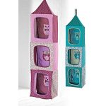 beautiful purple and blue hanging stuffed animal design in the shaped of house with three windows and wonderful animal patterned inside