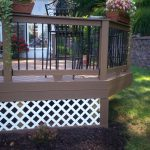 Beautiful White Lattice Porch Skirting Idea With Brown Porch Design With Black Metal Fencing Idea With Beautiful Flower Decoration