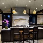 best floors for kitchens with tile and wooden cabinets with marble countertop and kitchen island with comfy chairs and lovely pendant lighting