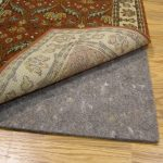 best rug pads for hardwood floors with grey natural fiber under the modern ornament rug