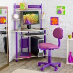 breattaking purple studen desk design in corner spot with purple swivel chair with computer set and colorful wall decoration upon white washed flooring