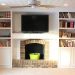 Brick Fireplace Mantel Design With Television Console With Ceiling Fan With Built In Bookshelves Design With Cream Wall Accent
