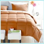 brown comforter cover two small table sides with white top