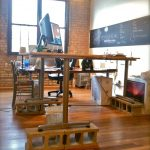 build your own stand up desk diy with additional stone under the desk legs with wheels and monitor plus wooden floor and swift chair