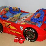 Cars Theme On Race Car Beds For Toddlers With Cars Bed Sheets And Pillow Plus Blankets And Toys On Brown Rug Floor And White Wall Paint
