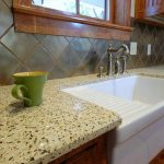 cheap countertop options with recycled glass material and white sink plus tile backsplashes and wooden kitchen cabinets for modern kitchen