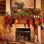 christmas decorations for mantels fireplace with stockings and garland plus ribbon and pretty candle holders plus artistic painting on wall