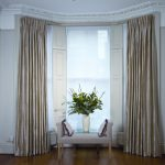 classy window treatments for wide windows combined with sofa bench and decorative cushions and wooden floor and flower vase