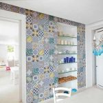 colorful casa antica tile design for bedroom in blue patterned tone  with wall racks and storage and white chair and blue chandelier