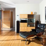comfortable black leather and brown reclining chair design aside beige wooden storage idea beneath wall palette with chair upon beige wooden floor
