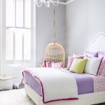 comfy chairs that hang from ceiling in bedroom for teenager with cute purple bedding and white rug plus pretty ceiling lighting and striped ceiling
