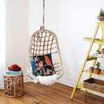 Comfy Chairs That Hang From The Ceiling With Decorative Cushion Plus End Table And Unique Wooden Racks With Plant Pot And Floor With Rug