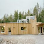 contemporary ranch design with wood planks wall plans and open windows and door for saving the energy
