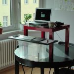 cool diy build your own stand up desk mounted on black round table combined with red wooden coffee table plus chairs and plastic box with wireles keyboard on wood plank