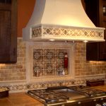 cream mosaic tile backsplash for kitche  beneath giant smokestack with center disctinctive pattern
