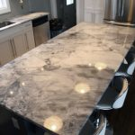 creative-modern-cool-nice-marble-look-countertop-with-dark-grey-abstract-decoration-wiht-black-flooring-design