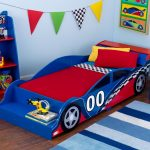 cute race car beds for toddlers with red and blue scheme combined with red and blue shelves with toys and story books plus stripped rug