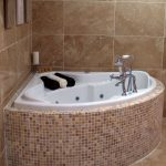 deep tubs for small bathrooms with tiled wall and floor with towels and candles for small bathroom ideas