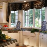 drapery window coverings for bay windows in kitchen with white cabinets and rug on wooden floor