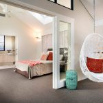 egg chairs that hang from ceiling for bedroom with red pretty cushion and grey rug and comfy bed