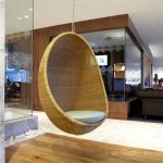 egg shape chairs that hang from the ceiling with wooden floor for home ideas