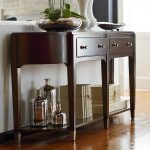 elegant brown wooden extra long console design with additional storage idea and drawersand beautiful decoration on the countertop and stainless fixtures