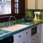 elegant-cool-nice-fresh-counter-top-with-attractive-green-concept-on-wall-and-on-table-with-nice-white-cabinet-design