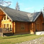 Elegant Log Home In Rustic Style With Darker Stained Wood Railings With Furniture