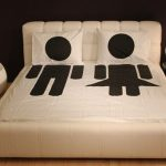 elegant sweet romantic white fun couple bed sheet design with dot pattern on the pillows and man and woman picture on the quilt