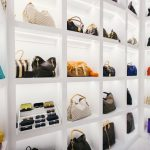 exclusive white handbag storage design with big pigeon hole slots made of white wooden material