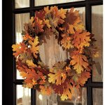 fall season pottery barn wreaths with dried leaves patched on glass front door