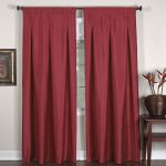 fashionable inverted pleat drapes in red combined wooden side table and flower pot and frame on wall decoration plus solid wooden floor
