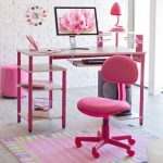 feminine pink student design design with slim table with storage and computer set and unique table lamp and pink swivel chair upon colorful area rug